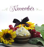 Beautiful Fall Thanksgiving theme cupcake with seasonal flowers and decorations for the month of November Royalty Free Stock Photography