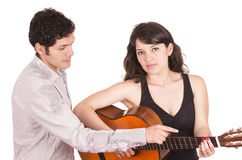 Beautiful female guitar student and teacher Royalty Free Stock Photos