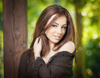 Beautiful female portrait with long brown hair outdoor. Genuine natural brunette with long hair in park. Attractive woman Stock Photo