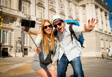 Beautiful friends tourist couple visiting Spain in holidays students exchange taking selfie picture Stock Photography