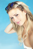 Beautiful blonde hair girl sitting near the pool in swimsuit. Summer concept Royalty Free Stock Photo