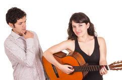 Beautiful happy female guitar student and teacher Royalty Free Stock Photography