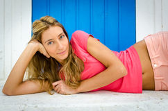 Beautiful Italian girl in pink t-shirt laying down Royalty Free Stock Photos