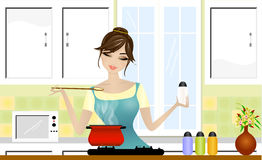 Beautiful lady cooking Stock Photography