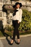 Beautiful ladylike woman wearing elegant blouse,pants and hat Royalty Free Stock Photography