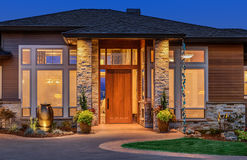 Beautiful Luxury Home Exterior in Evening, with Deep Blue Sky Stock Photography