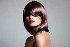 Beautiful model with perfect long glossy brown hair. Royalty Free Stock Image
