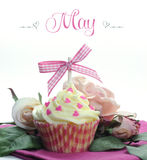 Beautiful pink heart or Mothers Day theme cupcake with seasonal flowers and decorations for the month of May Stock Image