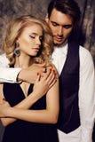 Beautiful sensual couple in elegant clothes posing in studio Royalty Free Stock Image