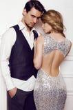 Beautiful sensual couple in elegant clothes posing in studio Stock Images