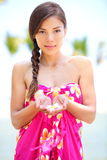 Beautiful serene woman on beach in sarong Stock Photography