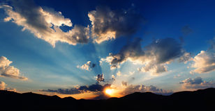 Beautiful sunrise in a mountains Stock Images