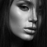 Beautiful woman with evening make-up and long straight hair . Smoky eyes. Fashion photo. Black white photo Stock Photo