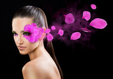 Beautiful woman with a flower Stock Photos