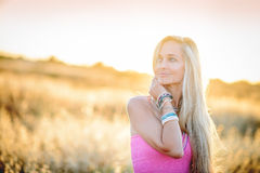 A beautiful woman in golden hay field 4 Royalty Free Stock Image