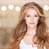 Beautiful woman with long curly hair. Stock Image