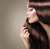 Beautiful woman with long smooth shiny straight hair Royalty Free Stock Photos