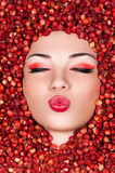 Beautiful woman lying in wild strawberry Stock Images