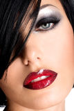 Beautiful woman with  sexy red lips and  eye makeup Stock Images