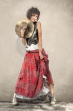 Beautiful woman in stylish long skirt with cowboy hat Stock Images