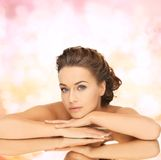 Beautiful woman with updo and mirror Royalty Free Stock Image