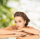 Beautiful woman with updo and mirror Stock Photo