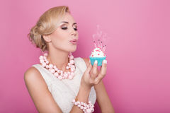 Beautiful women with cream dress holding small cake with colorful candle. Birthday, holiday Stock Photos