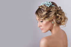 Beautiful young sexy elegant sweet girl in the image of a bride with hair and flowers in her hair , delicate wedding makeup Royalty Free Stock Images