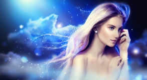 Beauty fantasy girl over night sky Royalty Free Stock Images