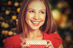 Beauty girl in red dress with gift box to Christmas or Valentine's Day Royalty Free Stock Photos