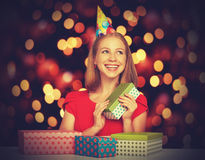 Beauty girl in red dress with gift boxes to Christmas or birthday Royalty Free Stock Photo