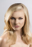 Beauty portrait of pretty blonde girl Stock Images