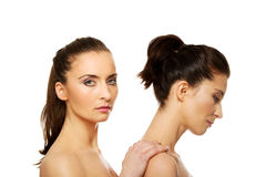 Beauty woman standing behind her friend. Royalty Free Stock Photography