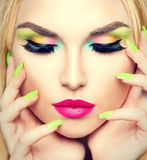 Beauty woman with vivid makeup and colorful nail polish Stock Photography