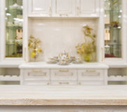 Beige table on defocused white kitchen furniture background Stock Image