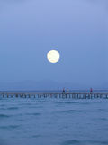 Big moon over pier Stock Photography