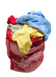 Big Red Mesh Laundry Bag Overflowing With Clothes Stock Photography