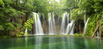 Big waterfall in the forest Stock Photos
