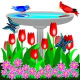 Birdbath and tulips Royalty Free Stock Photography