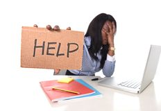 Black African American ethnicity frustrated woman working in stress at office Royalty Free Stock Image