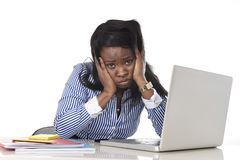 Black African American ethnicity frustrated woman working in stress at office Stock Image