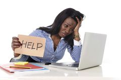 Black African American ethnicity frustrated woman working in stress at office Stock Photo