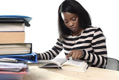Black African American ethnicity student girl studying textbook Stock Photos