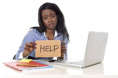 Black African American ethnicity woman in work stress at asking for help Royalty Free Stock Image