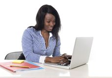 Black african american ethnicity woman working at computer laptop at office desk smiling happy Stock Photos