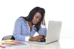 Black African American ethnicity worried woman working in stress at office Royalty Free Stock Photo