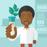 Black guy Chemist with tube and eco leaves Royalty Free Stock Photography