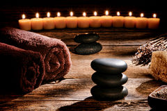 Black Polished Massage Stones Cairn in Rustic Spa Royalty Free Stock Photo