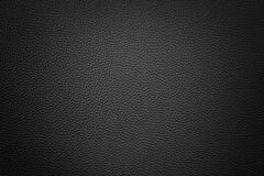 Black synthetic leather  background with vignette Royalty Free Stock Image