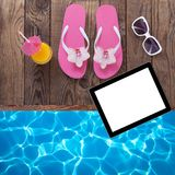 Blank empty tablet computer, summer accessories on Stock Photo